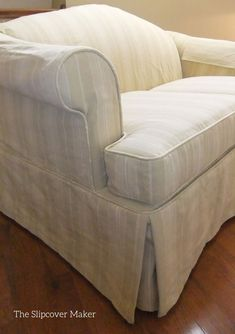 A new striped canvas slipcover updates the old cabbage rose upholstery. Check out this transformation...