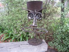 Shovel garden art made from recycled items.Stands 76 cm high.