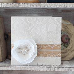 DIY flocked wedding invitation with flower detail. Make your own wedding stationery