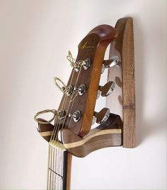 High Gloss, Lacquer Finish Walnut and Maple premium line wood guitar wall hanger.    For those who demand quality and design that properly showcases the