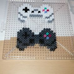 PS1 and PS2 controllers perler beads by jensperlercreations