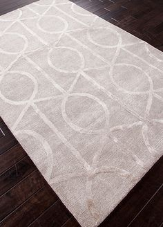 Over scaled sharp geometrics characterize this striking contemporary range of  hand tufted rugs. the high/low construction in wool and art silk creates texture and surface interest and gives a look of matt and shine.