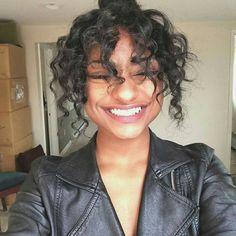 Bun with curly bangs