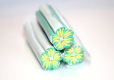 Green and Yellow Flower polymer cane  by PolymerClayMania on Etsy. , via Etsy.