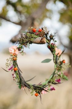 Annie likes the woodsieness of this one :) 16 Flower Crowns for Your Fall Wedding via Brit + Co.