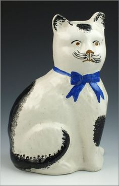 Rare Staffordshire pottery cat figurine decorated with sponge painted spots, Staffordshire, England 19th Cent.