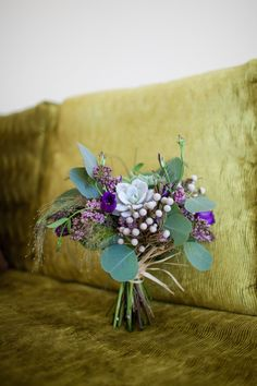 Lovely organic free-form bouquet with eucalyptus, succulents, brunia, lilacs and lisianthus.