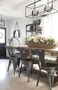 I love this dining room- the lights... and that mirror in the background is amazing