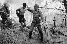 South Vietnamese soldier with a captured Communist soldier, 1966. ~ Vietnam War