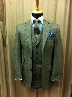 I believe this is a checked tweed suit...3 piece. The color scheme is truly dashing