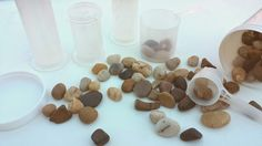 Rocks with plastic scoops and containers. Heather Hess: How to Create the Perfect Activity Box for Kids. A list of busy activities for toddlers in an organized way