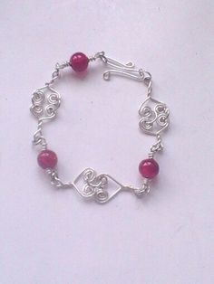 Celtic link heart shaped silver plated wired bracelet with red beads £6.00