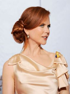 For a knot that's modern, not matronly, position it low and off to one side, a la Nicole Kidman.