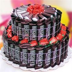 This Hershey Cake Bouquet is perfect for Birthday's or any other occasion.This two tier cake is made up of 50 fun size Hershey's Chocolate bars 15 Miniatures, 25 Strawberry filled candies packaged on cake board, wrapped in cellophane gift Hershey Cake, Hershey Candy Bars, Hershey Chocolate Bar, Cake Chocolate, Chocolate Heaven, Chocolate Bouquet, Chocolate Lovers, Candy Bar Bouquet, Cake Bouquet