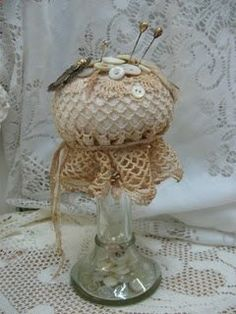 Pin cushion made on vintage candle stick.