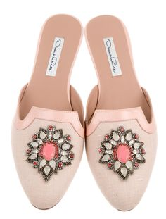 Pink canvas Oscar de la Renta round-toe mules with leather trim, tonal stitching, crystal embellished appliqué at vamps and stacked heels.