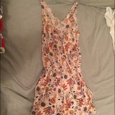 Flower print romper Only worn a few times H&M romper, size xsmall, color is a sort of cream & peachy color H&M Pants Jumpsuits & Rompers
