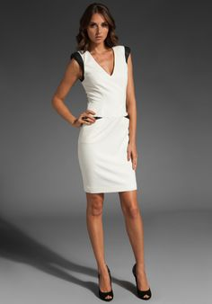Kind of obsessed with white dresses right now.  Love this one!