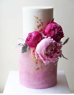 21 Two-Tiered Cakes That Prove Bigger Isn't Always Better - ombre pink two tiered wedding cake with peonies and gold fleck accents