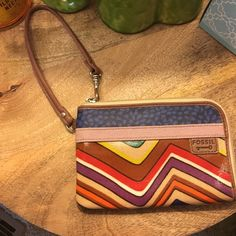 EUC Gorgeous Multi Colored Fossil Wristlet This Wristlet is in truly excellent used condition with hardly any wear. 2 pin sized dots on material but otherwise looks new. Love the bright multi colored pattern! Fossil brand. 18may16bako Fossil Bags Clutches & Wristlets