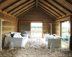 Aires Mateus and Assoc. - traditional Portuguese fishing hut, renovated for modern living. The sand floor is warmed by a radiant-heat system.