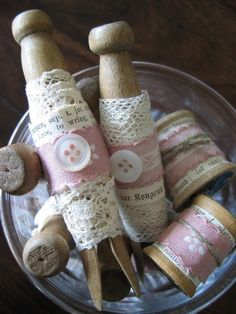 Wooden clothes pins, lace and spools