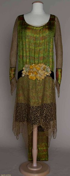 Circa 1925 Gold Lace and Brocade evening gown: bodice and back train panel of green, coral, and metallic gold brocade, gold lace sleeves and skirt w/reverse scallop hem, and black silk moire hip sash w/center beige velvet flowers.