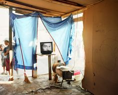 Magnum Photos -  Jim Goldberg GREECE. 2003. A Roma (gypsie) camp on the outskirts of Athens. Living room.