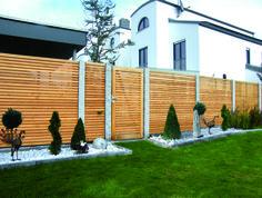 Holz Sichtschutzzäune | Holzland Hundshammer Lärche lasiert, individuell gefertigt,