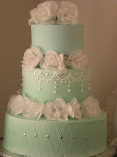 silver white and blue wedding cake
