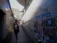Obvious Norwich aspect. I like the framing of the girl using the walkway. The background building seems over exposed.  ~Ian Coldicott - Underpass from Flickr