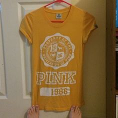 Victoria's Secret Pink tight fitting t-shirt! I bought this t shirt a long time ago but just found that I didn't wear it much. It's in amazing condition, just a bit wrinkled from being in my closet. Super duper comfy!! PINK Victoria's Secret Tops Tees - Short Sleeve