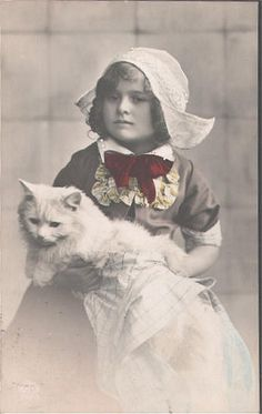 Cats in Photography: Dutch girl with cat #NoordHolland #Volendam
