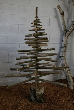 A Christmas tree made from tree branches and the base is a stump. Some people sure have a knack.