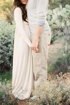 Gorgeous soft neutral tones in their outfits for an ethereal film engagement session, perfect outfit idea!