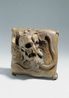 Paul Egell (1691-1752), 'Memento mori', c. 1720-25. H. 13,5 cm x 24,8 cm. Memento Mori. Pearwood, monochrome tint. The skull confronts one with the transitoriness of all life. The process of decay is rendered with drastic sensuality - from the decomposing skin to the animals that in the poetry of the time inhabit the grave: toads, snakes, lizards. -The Germanisches Nationalmuseum, Nürnberg-