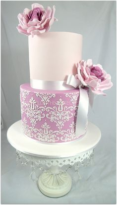 Pink cake with flowers and stenciled bottom tier - by Michelle The CakeChef