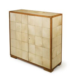 A French Art Deco Cabinet parchment and sycamore circa 1930.
