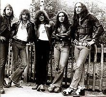 """Uriah Heep are an English rock band formed in London in '69, regarded as one of the seminal hard rock acts of the early '70s. Uriah Heep's progressive/art rock/heavy metal fusion's distinctive features have always been massive keyboards sound, strong vocal harmonies and David Byron's operatic vocals. In '70s the band had massive success in Germany, where the """"Lady in Black"""" single was a big hit. Along with Black Sabbath, Deep Purple and Led Zeppelin, it has become one of the top bands in the…"""