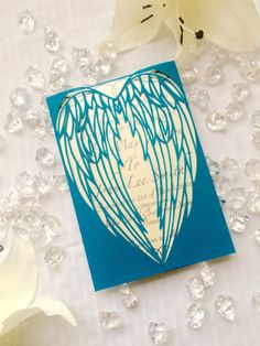 This is a stunning cut angel wings gatefold winter wedding invitation. This unique cut paper pattern is cut so that the intricate wings will enclose your invitation behind their detailed love making an elegant invite. FOR SAMPLES, Please indicate the following under note for seller or in a conversation: -Exterior gate color (from color chart above) -Interior paper color (from color chart above) -Envelope color (white, natural, or black) -Any additional colors you would like to see to compare…