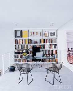 A full, colorful wall of bookshelves can be a chic backdrop for an at-home desk. Source: Elle Decor