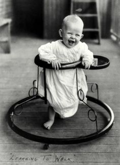 Learning to Walk: 1905.  If he's happy with his walker... we should be too.  Mobility is what is important.