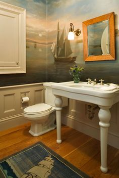 Nautical sea ship mural in bathroom by Anne Harris. To see another stunning painted coastal mural, click here: http://www.completely-coastal.com/2010/09/rate-this-room-beach-wall-mural.html