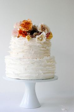 Cute idea-- collection of smaller, coordinating cakes instead of one larger cake with many tiers || Colin Cowie Weddings