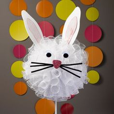 Easter fun! DIY an Easter Bunny Topiary from deco mesh and other basic supplies. Cute as can be!