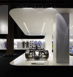 "Retrospective Formula 1 Exhibition of Fernando Alonso: On display at the Sala Arte Canal in Madrid, the ""Fernando Alonso Collection"" showcases the world Visual Merchandising, Design Blog, Store Design, Home Libraries, Branding, Design Museum, Exhibit Design, Alonso, Design Furniture"