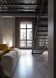 Unique grate-style treads give this staircase a very modern industrial look.
