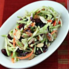 Broccoli slaw salad with dried cranberries, toasted almonds, and a honey-yogurt dressing