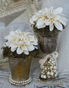 Cute way to repurpose vintage jewelry and planters.