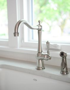 Beautiful faucet from a character kitchen renovation by Madeleine Design Group in Kitsilano, Vancouver. Renovations, Functional Kitchen, Kitchen Renovation, Homey, Metal Fireplace, Dining Nook, Wood Accents, Fireplace Surrounds, Character Home